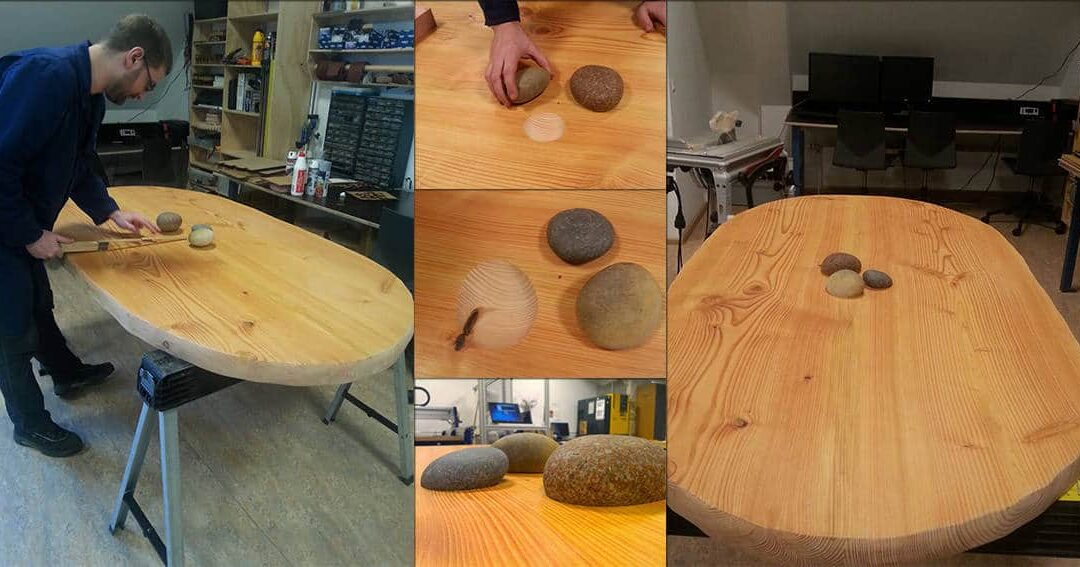 Step 1 – A standing meeting table with organic top and stone inlays is in progress..